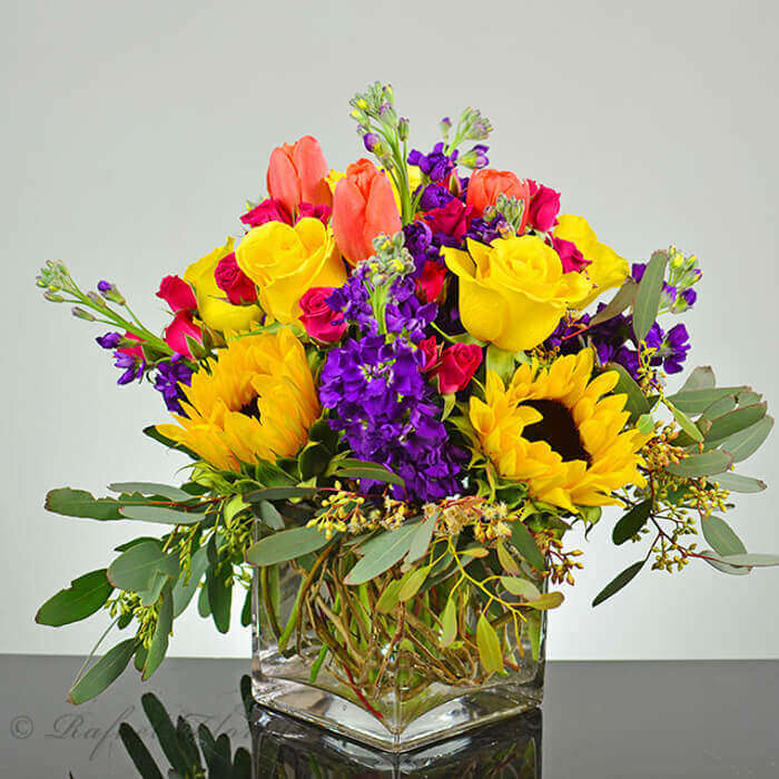 Cheerful Flower Arrangement Of Sunflowers, Tulips Roses