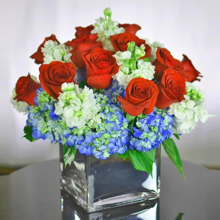 Amazing grace red white blue flower arrangement of roses for Red white blue flower arrangements