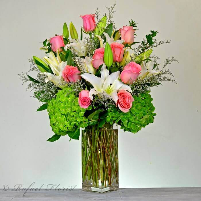 A stunning design of soft pink roses fragrant white lilies and home mightylinksfo